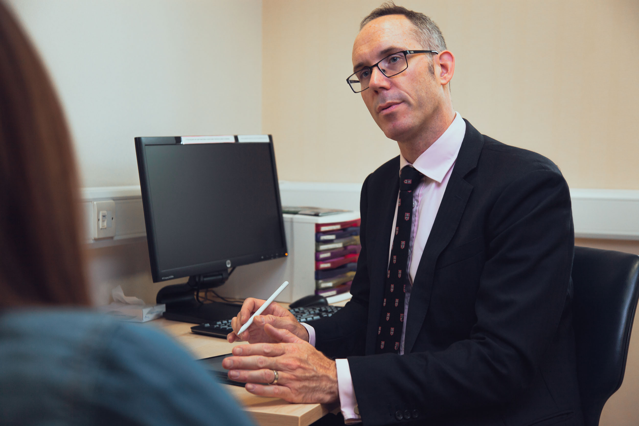 Surgeon Sinclair Gore consulting with patient in his Oxford office